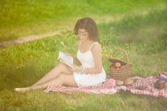 Beautiful woman on picnic on nature. Beautiful Young girl Outdoo Stock Photo