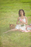 Beautiful woman on picnic on nature. Beautiful Young girl Outdoo Stock Images