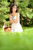 Beautiful woman on picnic on nature. Beautiful Young girl Outdoo Stock Image