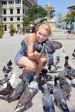 Beautiful woman with pigeons in Havana stock photography