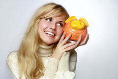 Beautiful woman with a piggy bank Stock Photography