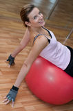 Beautiful Woman on a Pilates Ball. A beautiful young woman with her back on a pilates exercise ball Stock Photo