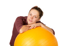 Beautiful woman with a pilates ball Royalty Free Stock Image