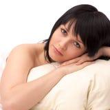 Beautiful woman with pillow Stock Photos