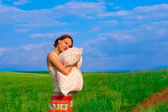 Beautiful woman with pillow in the elbowroom Royalty Free Stock Photos