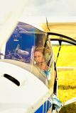 Beautiful woman the pilot in a cockpit of the ultralight plane Royalty Free Stock Photography