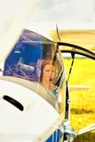 Beautiful woman the pilot in a cockpit of the ultralight plane Royalty Free Stock Image
