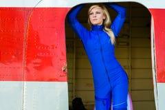 Beautiful woman pilot in the door plane Stock Photos