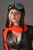 Beautiful woman pilot in red scarf in aviator helmet Royalty Free Stock Image