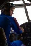 Beautiful woman pilot at wheel airplane Royalty Free Stock Images