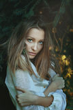 Beautiful woman among pine branches Royalty Free Stock Images