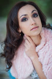 Beautiful woman in a pink cape walks in the park Royalty Free Stock Photography