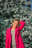 Beautiful woman in a pink coat in blooming gardens Stock Images
