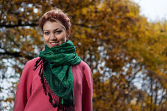 Beautiful woman in pink coat walks in the Park Royalty Free Stock Photography