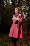 Beautiful woman in pink coat walks in the Park Stock Image