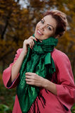 Beautiful woman in pink coat walks in the Park Royalty Free Stock Image