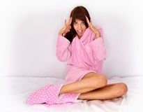Beautiful woman in pink cosy sleepwear on the bed. Stock Images