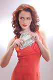 A beautiful woman in a pink dress with dollar banknotes in the hands. Christmas, x-mas, sale, banking concept - smiling woman in red dress with us dollar money stock images