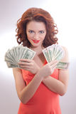 A beautiful woman in a pink dress with dollar banknotes in the hands Royalty Free Stock Image