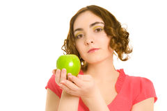 Beautiful woman in pink dress with green apple Stock Photo