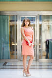 Beautiful woman in pink dress in the shop Stock Image