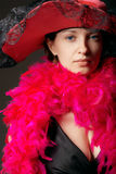 Beautiful woman in pink feathers and hat Royalty Free Stock Photography