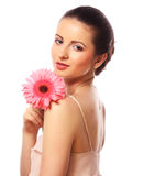 Beautiful woman with pink flower isolated on white Stock Photography