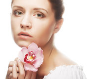 Beautiful woman with pink flower Royalty Free Stock Photo