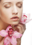 Beautiful woman with pink flower Stock Photography