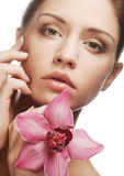 Beautiful woman with pink flower Stock Photos