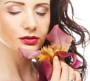 Beautiful woman with pink flower Royalty Free Stock Images