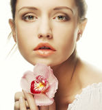 Beautiful woman with pink flower Stock Image