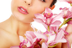 Beautiful woman with pink flower. Stock Photo