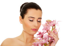 Beautiful woman with pink flower. Royalty Free Stock Images
