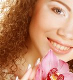 Beautiful woman with pink flower Royalty Free Stock Image