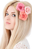 Beautiful woman with pink flowers in hairs Stock Photography