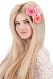 Beautiful woman with pink flowers in hairs Stock Photos