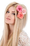 Beautiful woman with pink flowers in hairs Royalty Free Stock Photography