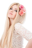 Beautiful woman with pink flowers in hairs Stock Images