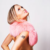 Beautiful woman in a pink fur collar Stock Image