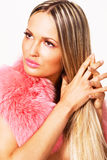 Beautiful woman in a pink fur collar Stock Images