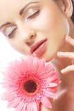 Beautiful woman with pink gerber Royalty Free Stock Photo