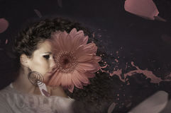 Woman and pink flower. Beautiful woman with pink gerbera Stock Photo