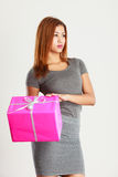 Beautiful woman with pink gift. Royalty Free Stock Images