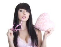 Beautiful woman in pink glasses with plush heart Royalty Free Stock Photography