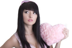 Beautiful woman in pink glasses with plush heart. Beautiful woman in pink glasses with plush pink heart stock photo