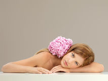 Beautiful woman with pink hydrangea on shoulder Stock Images
