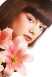 beautiful woman with pink lily flower Royalty Free Stock Image