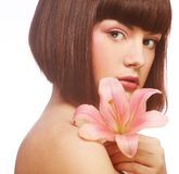 Beautiful woman with pink lily flower Stock Photo