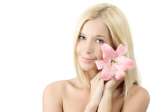 Beautiful woman with pink lily smile isolated Royalty Free Stock Photos